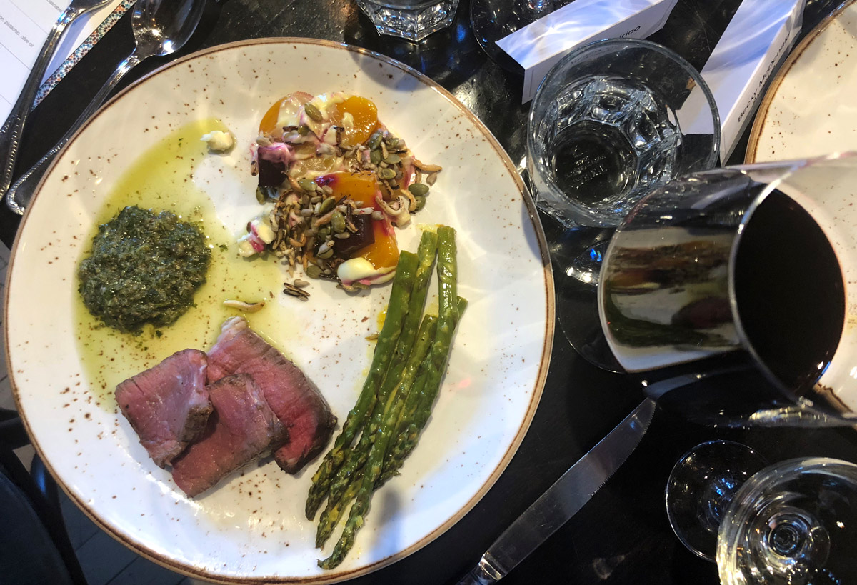 The main course dishes were served family style and included dry aged porterhouse with chimichurri, charcoal roasted beets with blue cheese, and asparagus.