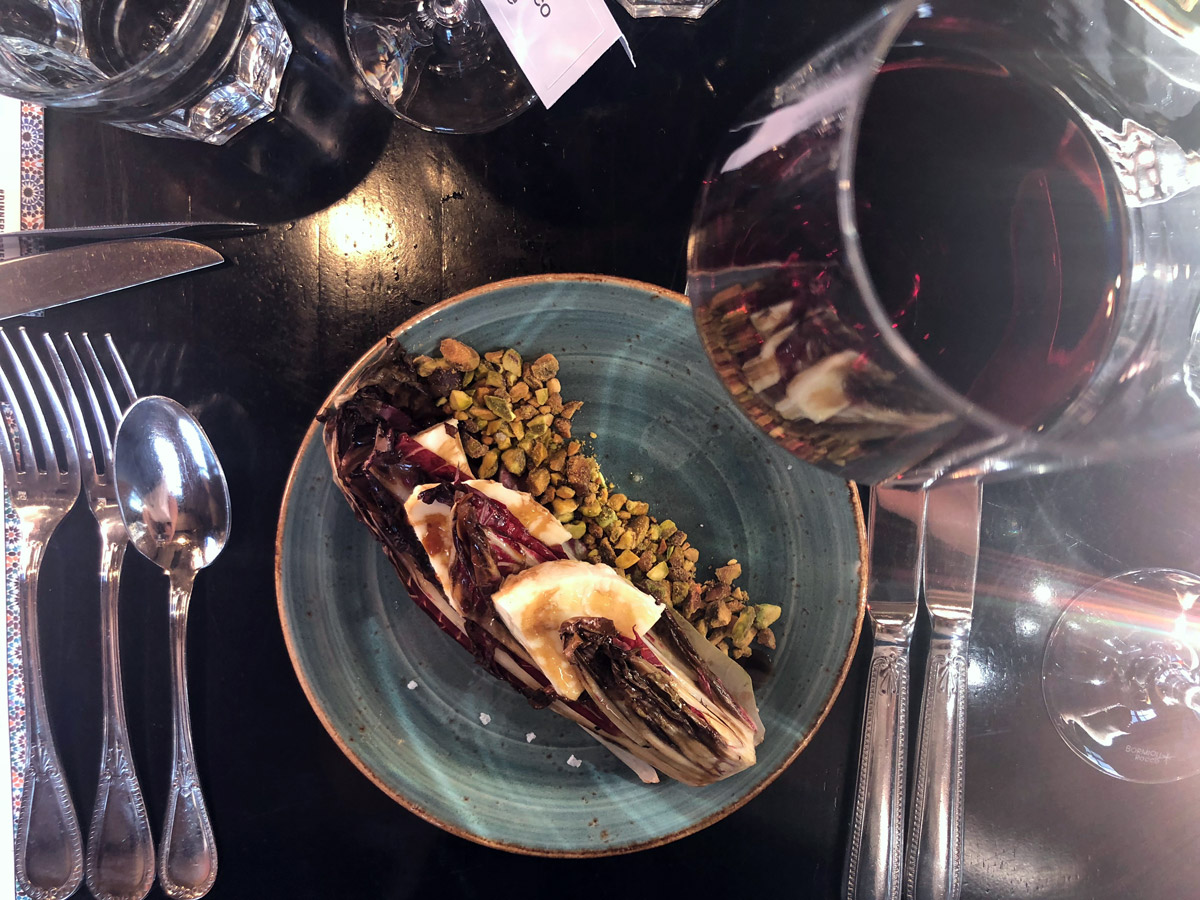 The second course was a grilled Italian radicchio salad with local fior di latte cheese topped with a sherry reduction, crunchy pistachios and olive oil.
