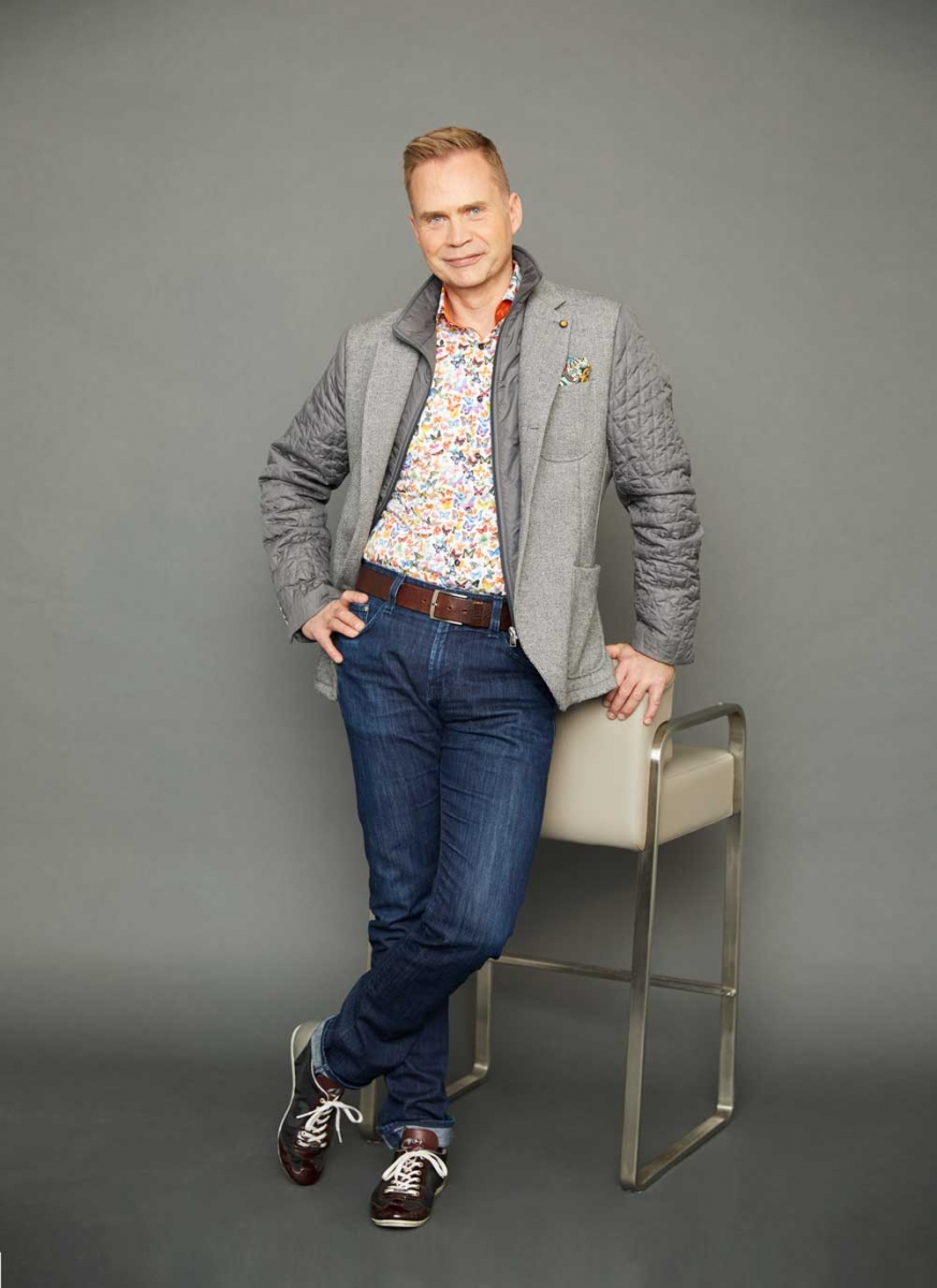 Jacket by Roberto P Luxury, butterfly shirt by 7 Downie St., both from Supreme Men's Wear; jeans by AG, belt from Hudson's Bay; shoes by Cruyff; pocket square by Roberto P Luxury; 007 Stool supplied by Limitless.