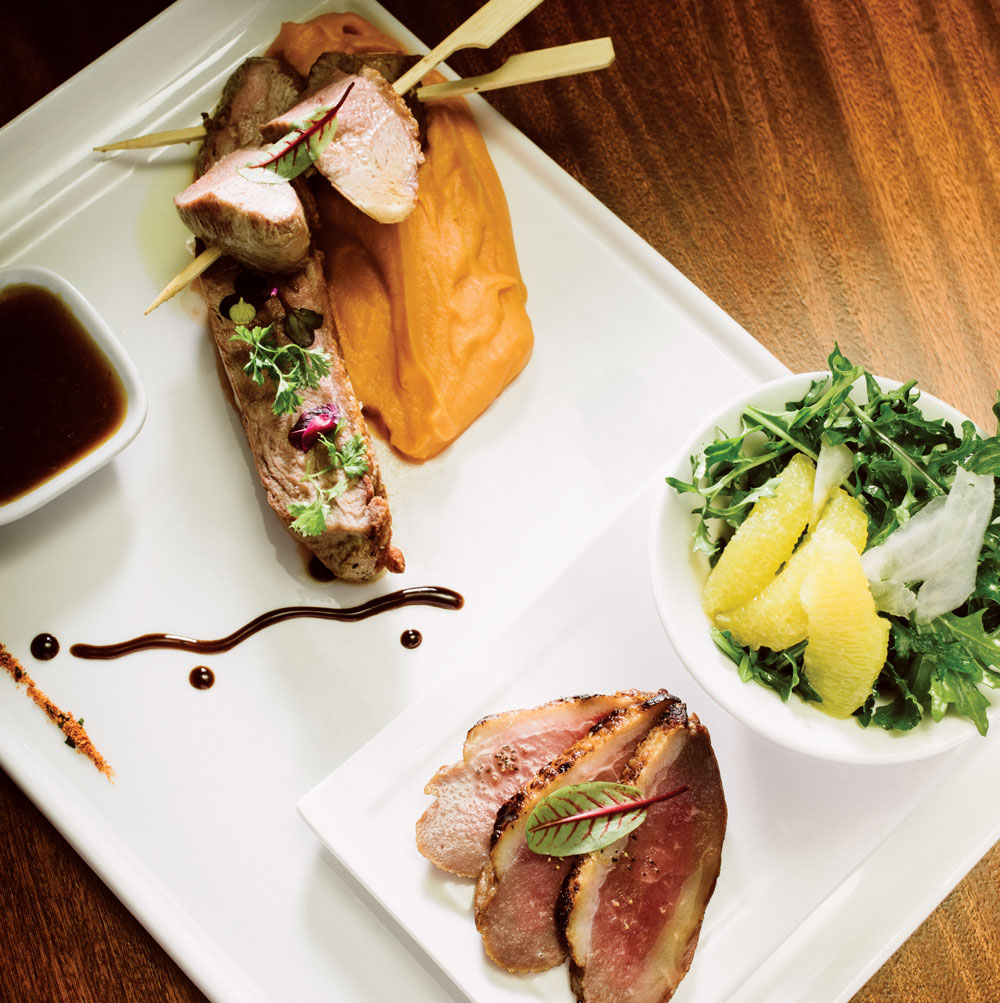 Duck breast skewers (yakitori), arugula orange salad, sliced smoked duck breast, pumpkin purée and honey chili gastrique.