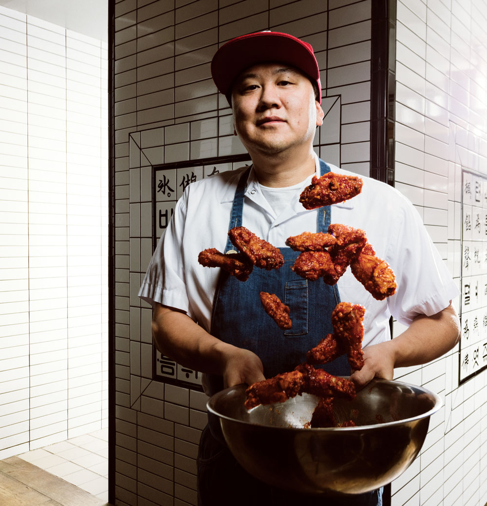 Chef Roy Oh preparing his signature gochujang chicken wings.