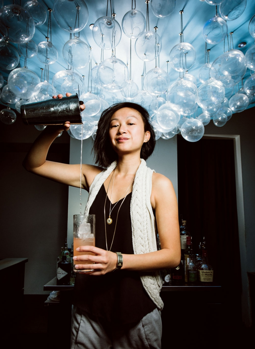 General manager and mixologist Christina Mah pouring a signature cocktail.