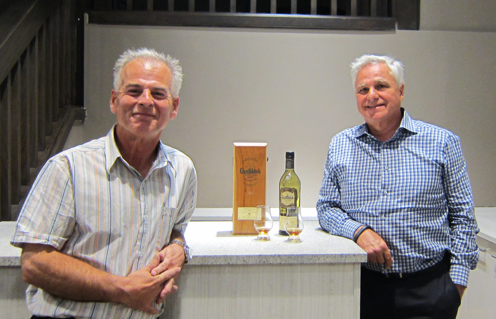 Willow Park Wine & Spirits scotch expert David Michiels and owner Wayne Henuset taste a 1975 Glenfiddich at the new mixology centre and tasting bar.