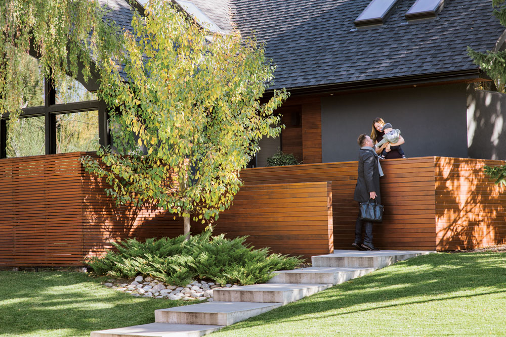 Kelly and Brad Morrison were able to maintain the mid-century feel of the home while achieving privacy with this custom fence Kelly designed herself.