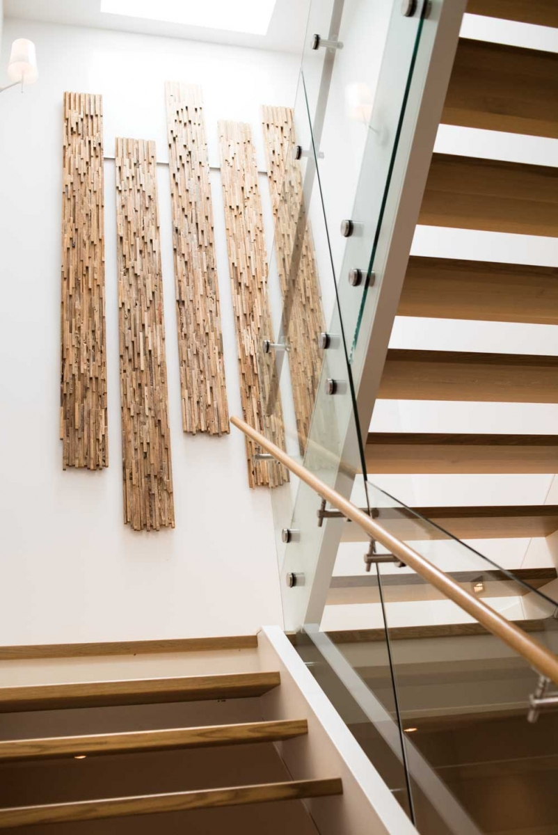 Homeowner and designer Chris Lemke created the staircase art piece out of salvaged wood sourced from Salt Spring Island.