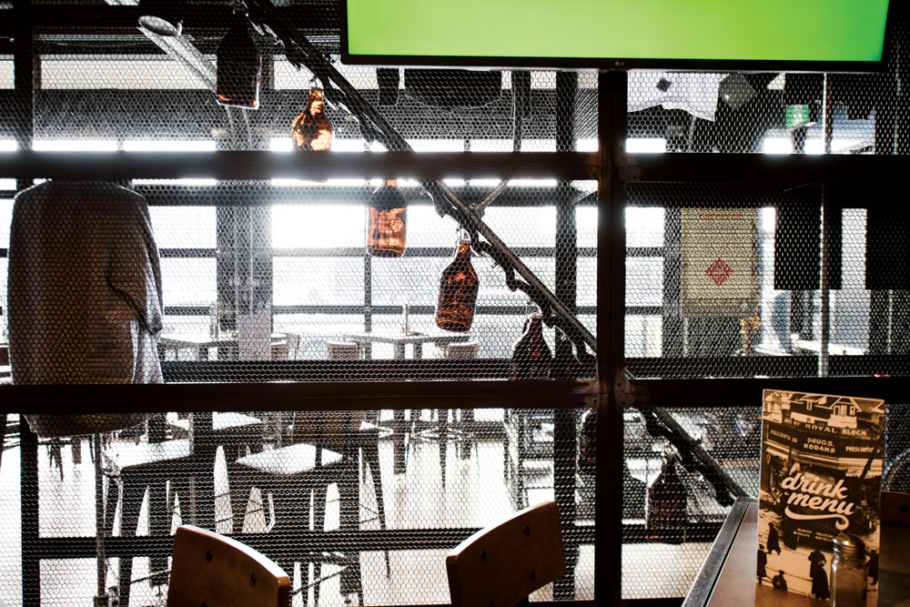 A moving conveyor of growlers makes beer part of the decor at Trolley 5.
