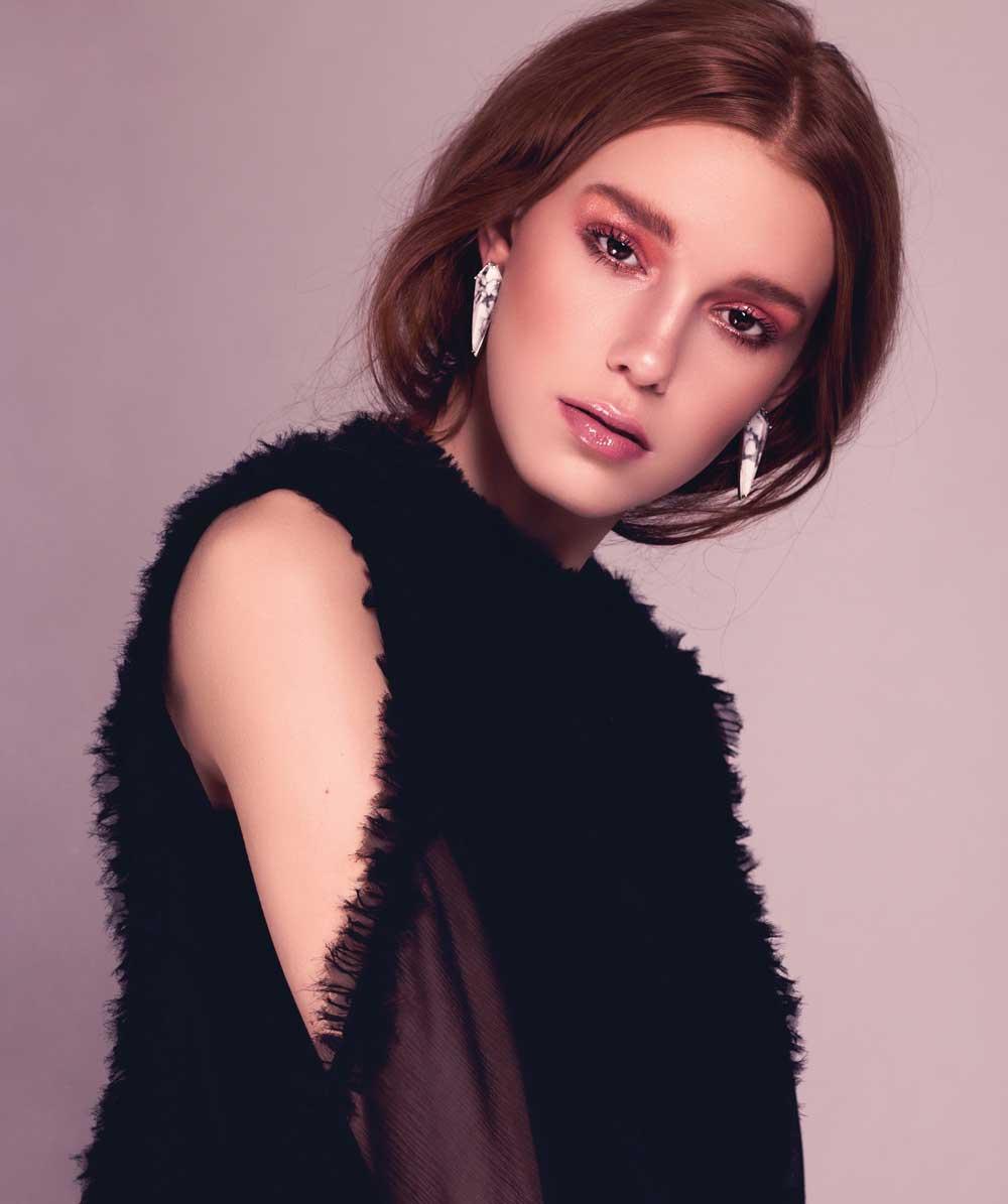 Alexie black top, 30, from Holt Renfrew; Tavani statement earrings, 15, Hillberg & Berk.