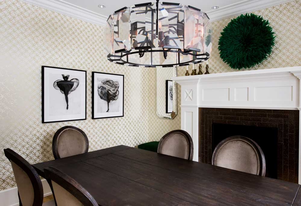 The family's formal dining room also features black and white artwork by Cathy Daley, as well as a piece of artwork bought off Etsy over the fireplace.