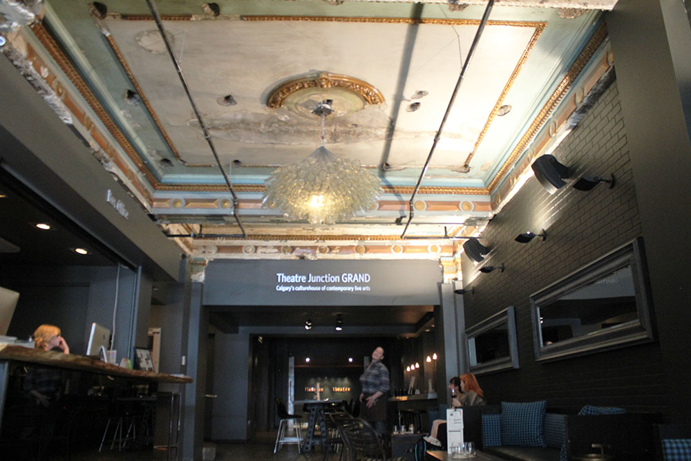 Theatre Junction's renovation saw a number of old features returned, such as the original ceiling from 1912. The ceiling still has scars from its many prior renovations, including a number of holes used by Odeon to install a cork board ceiling, which completely covered its art deco style. The chandeliers were made by Montreal artist Eric Sauvé using broken wine bottles.