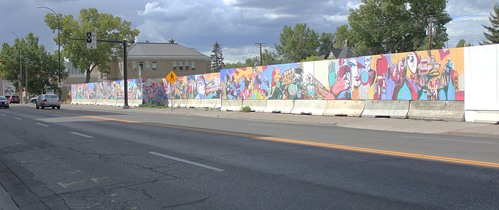 The longest stretch of mural is on 9 Avenue S.E. It continues around the corner on the hoarding boards on 9 Street S.E.