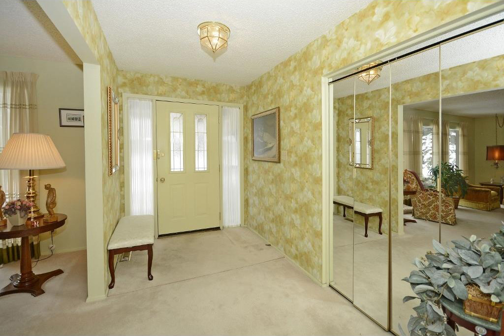 Embellished wallpaper highlights the entryway.