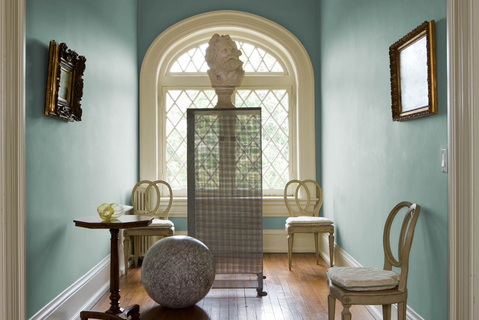 Dixon uses C2 Paint's Misty Morn as a clean and cool backdrop in this traditional room.