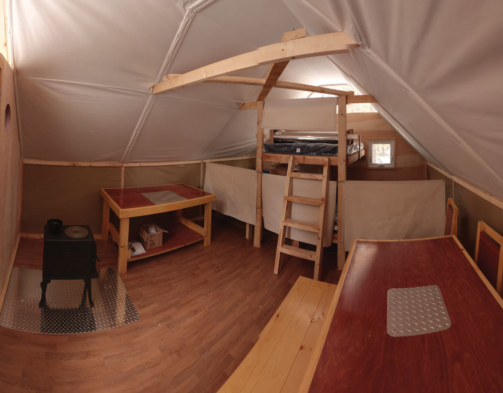 The interior of an oTENTik cabin is spacious and luxurious.
