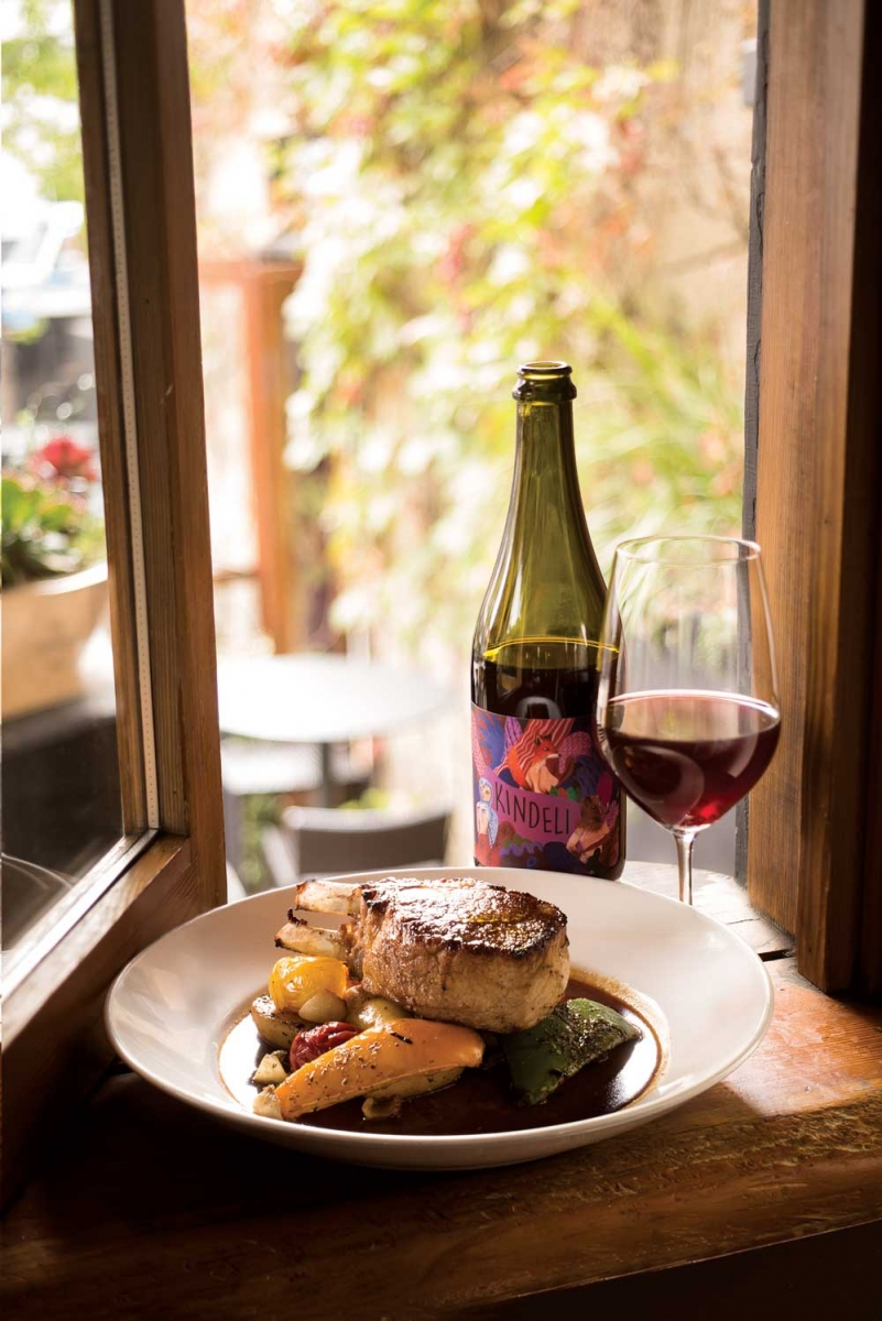 Berkshire pork chop paired with Kendeli pinot noir-syrah at Cilantro.