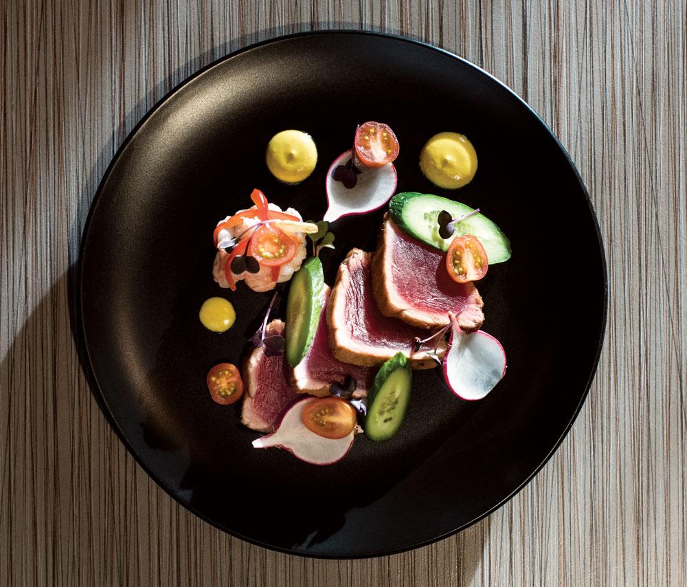 Chili-crusted ahi tuna, aji amarillo and coconut reduction and langoustine aguachile.
