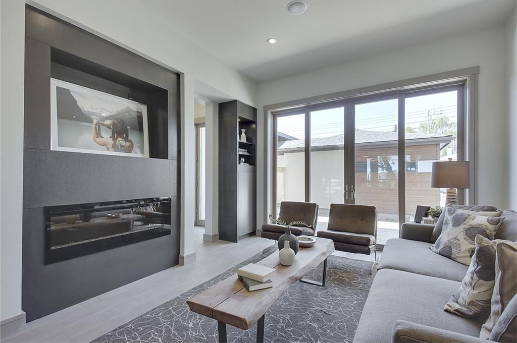 The living room has triple-glazed Kolbe glass doors that help regulate the internal temperature of the home.