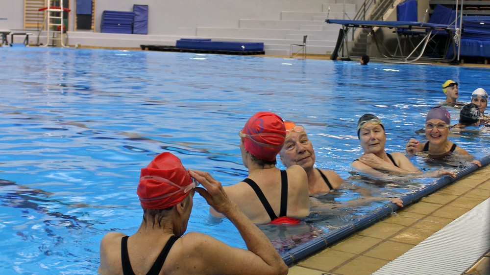 Before training gets started, the ladies chat, catch up and swim a few laps of the Talisman Centre's dive tank to warm up.