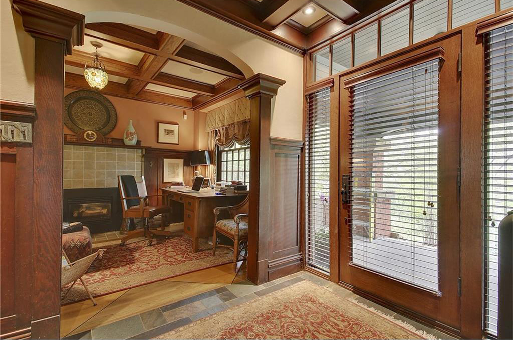 An office, with an original fireplace, sits directly off the large front porch and entryway.