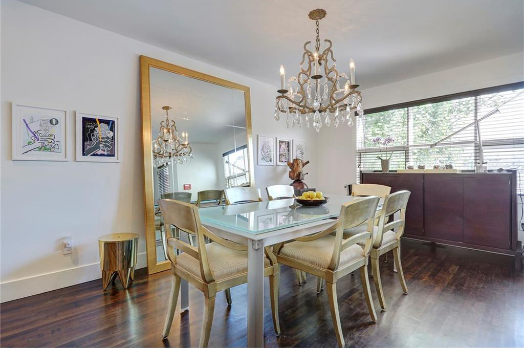 It has refinished hardwood floors throughout including in the dining room.