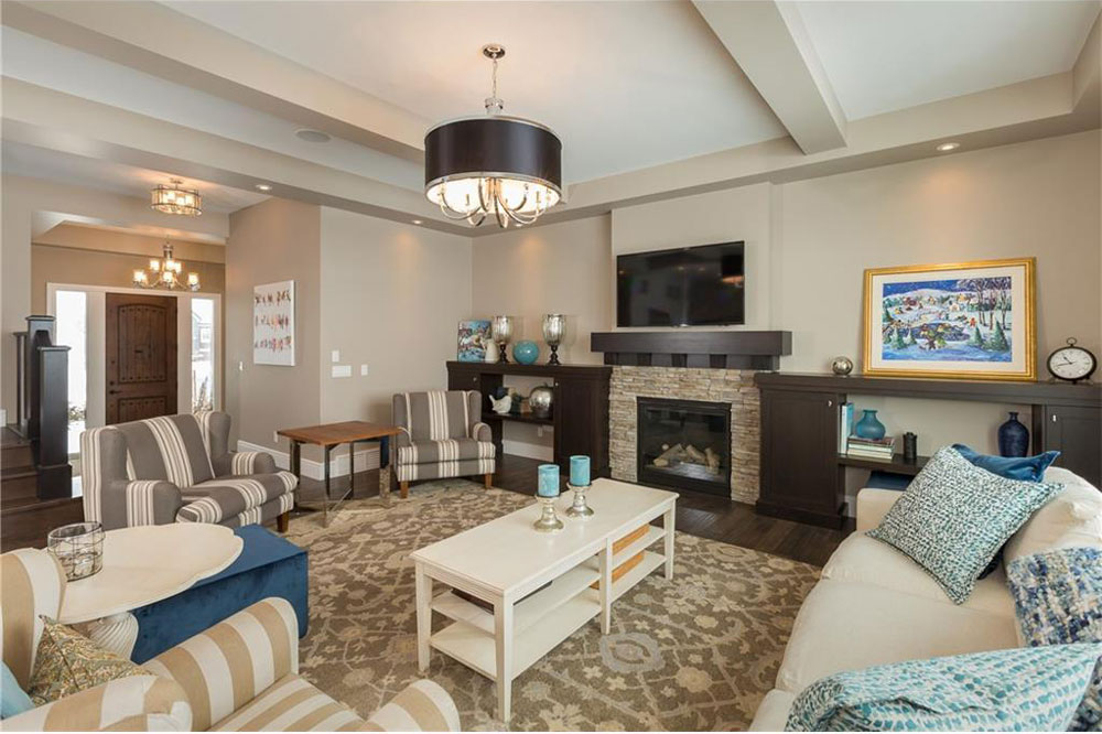 There's a large living room with a fireplace on the main floor.