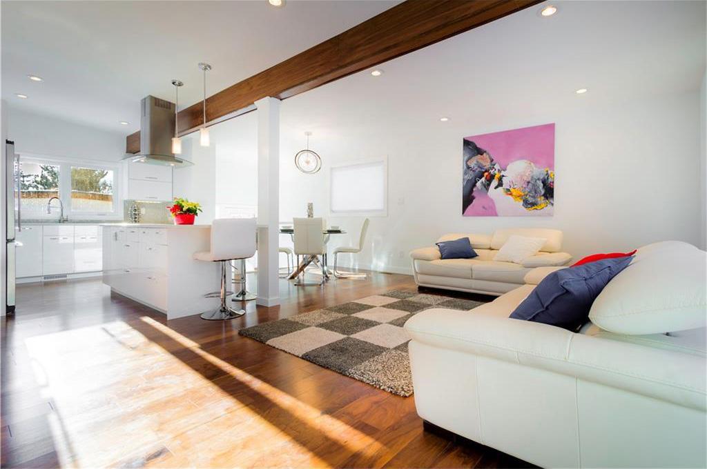 The open concept living room has new hardwood floors.